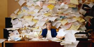 woman overwhelmed by paperwork