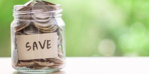 coins in a glass jar save money