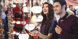 couple shopping at a bazaar