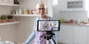 Senior female filming a cooking vlog