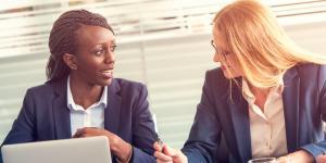 two business women talk
