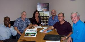 Broward SCORE counselors work on an updated Business Plan with the management team of Gold Tone Products.  Pictured L-R :  Kenrick Pierre,Broward SCORE ; Bryan Pasley, Diane Pasley and Marc Mendelsohn of Gold Tone Products ; and Ernie Cevallos and Dave Harris, Broward SCORE