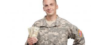 military veteran holding cash
