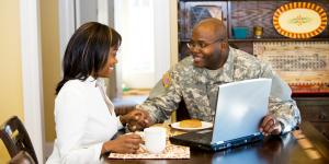 veteran and wife at laptop
