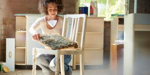 woman restores old wooden chair