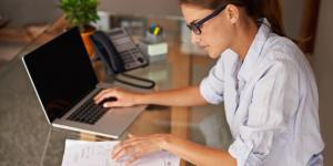 woman working on finances on laptop