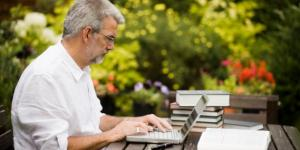 Entrepreneur using Google Alerts on laptop