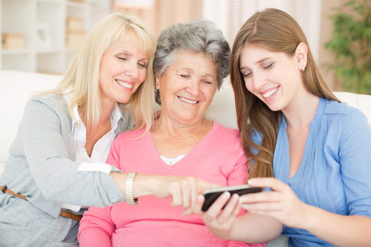 three generations of women using phone