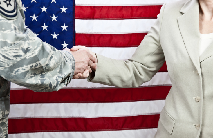 veteran and business woman handshake