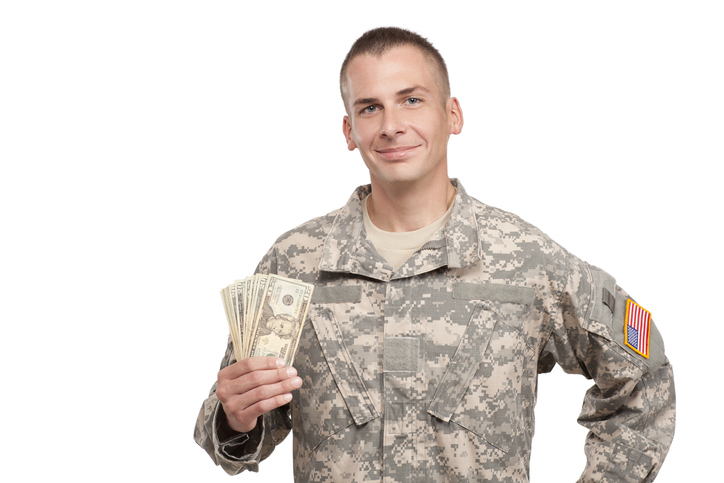 military veteran holding cash
