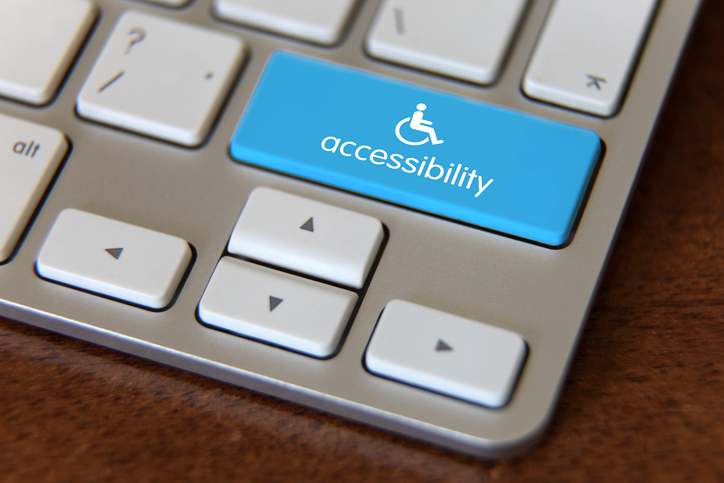 wheelchair logo on keyboard