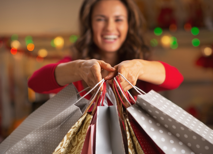 woman holding holiday shopping bags