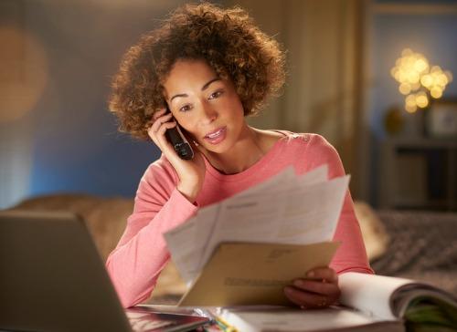 woman on telephone paying bills