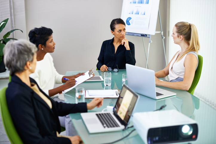 women entrepreneurs in a meeting around a table