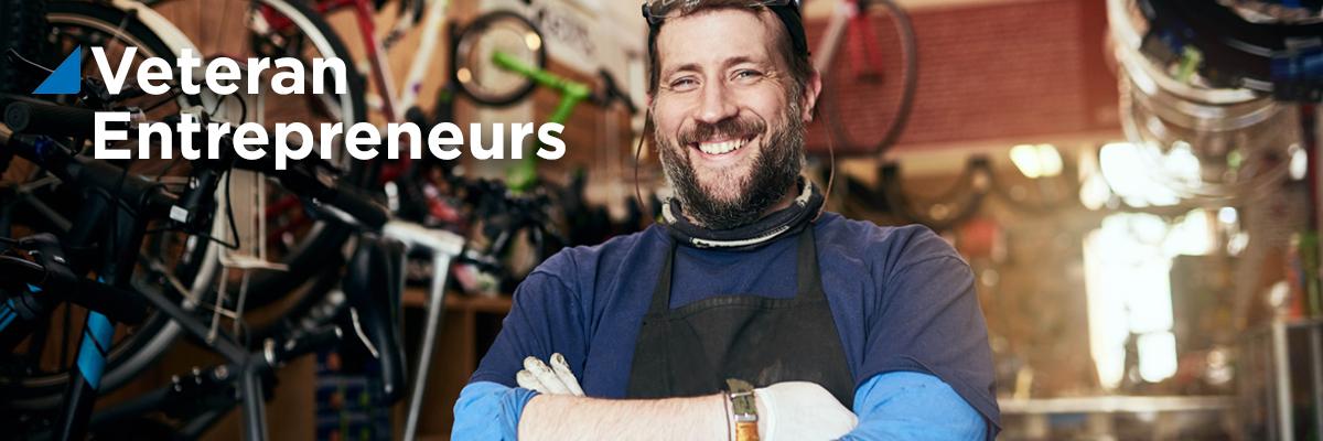 Bike shop owner smiling at camera