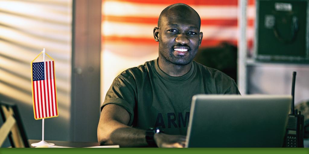 Veteran at desk on laptop