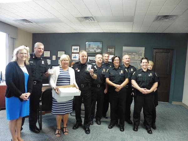 Image of Susan Wajert, Lori Edgeworth, and TPD Officers