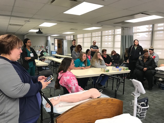 Image of Mercy College students observing simulation for healthcare
