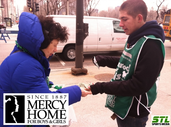 Tom Groff sells shamrocks for Mercy Home.