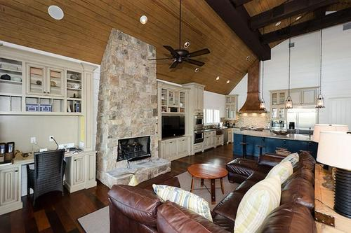 Living room has desk and gas log fireplace