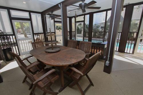 Teak dining table on screened porch