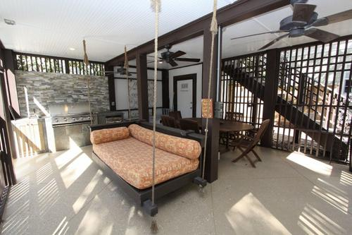 Relaxing day bed in screened porch