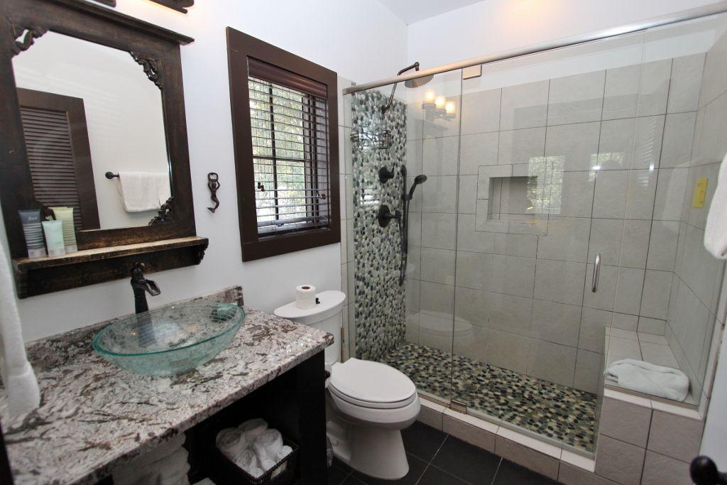Master bath with pebble tile in shower