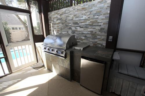 Outdoor grill and sink in porch area