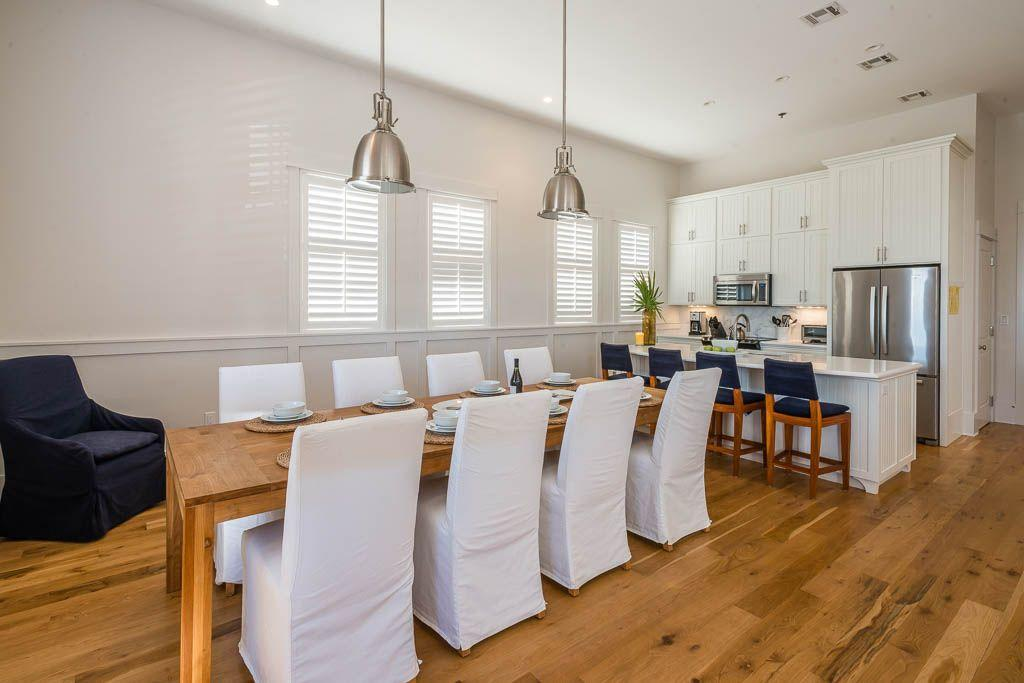 Dining table showing kitchen island in background
