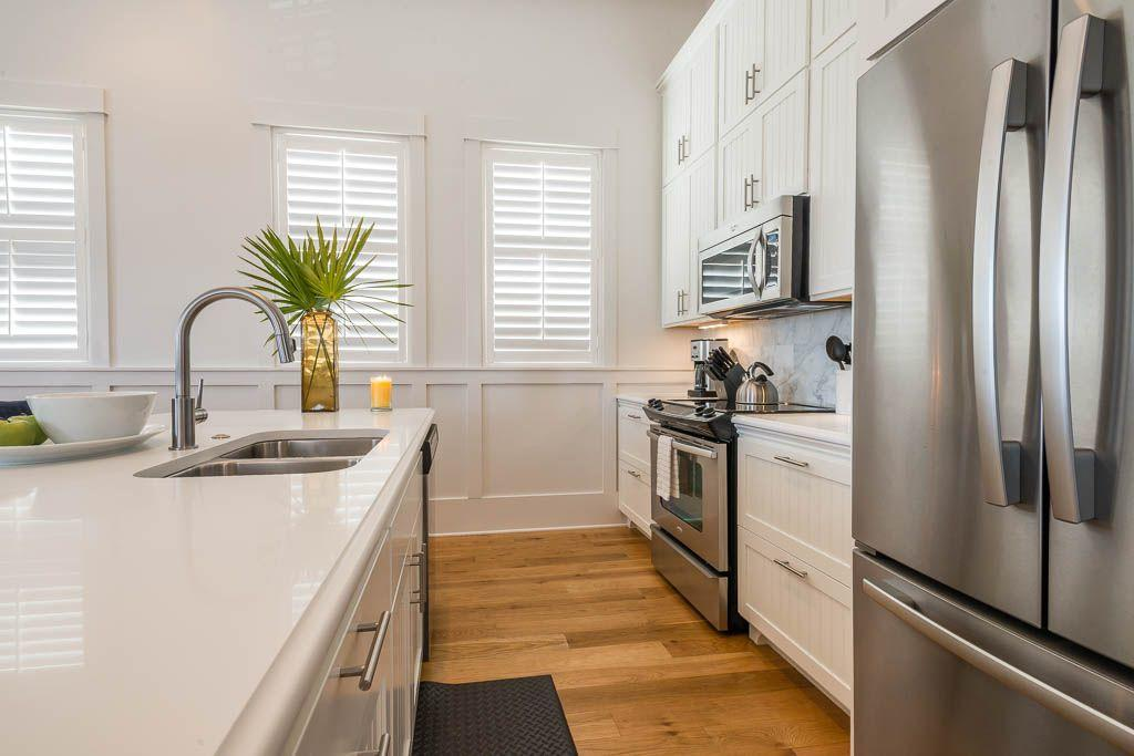 Kitchen has stainless whirlpool appliances