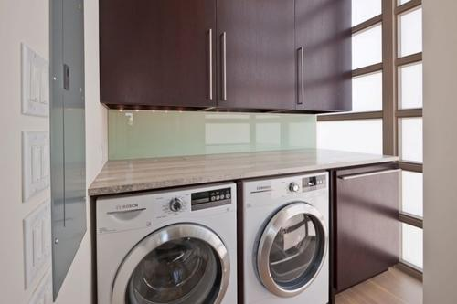 Large laundry room with front loaders