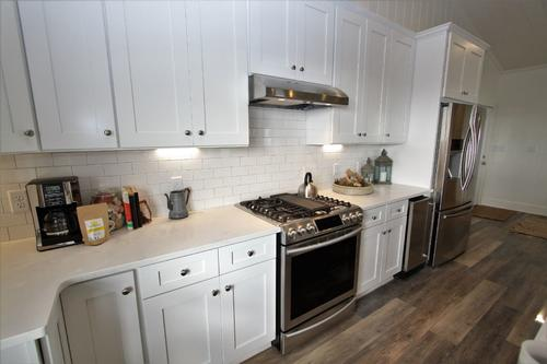 Renovated kitchen with gas stove