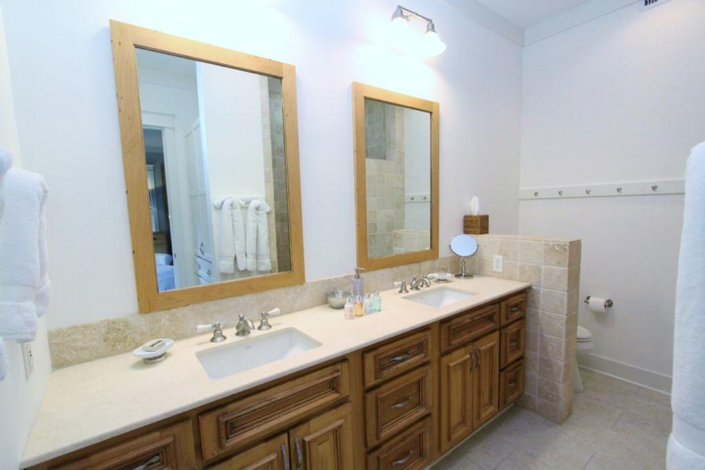 Master bath with his her sinks and walk in shower