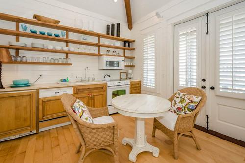 Carriage house kitchen with cafe table