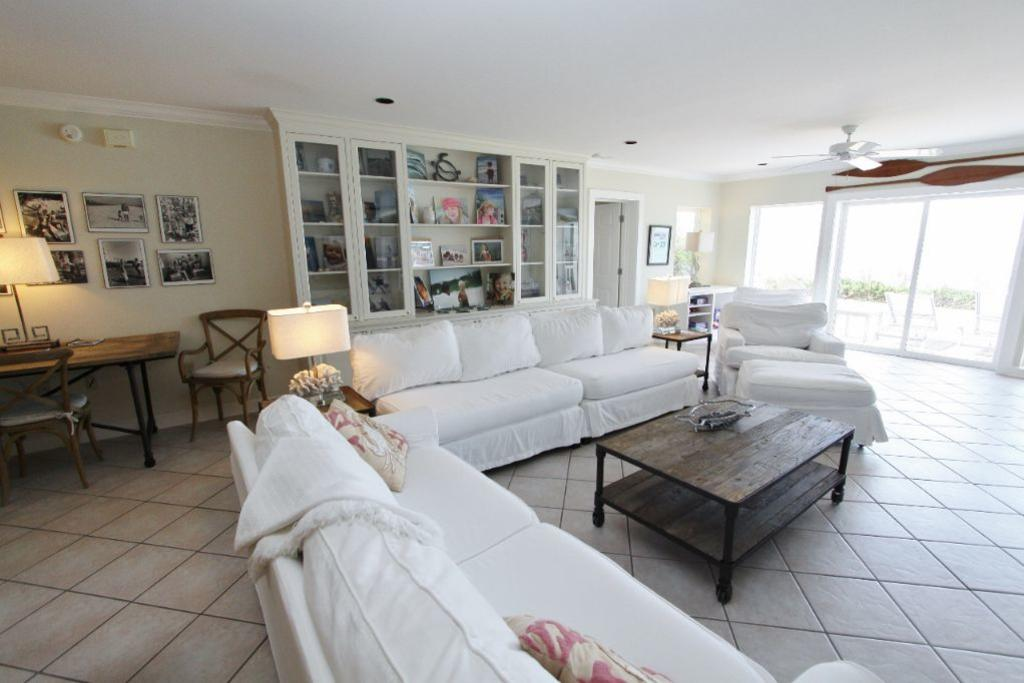 Yellow house seagrove beach beach vacation rental fl - Multiple seating areas in living room ...