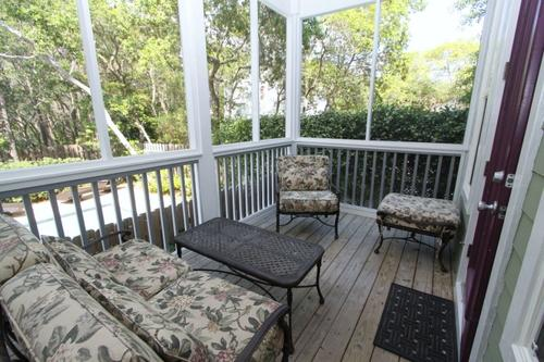 Screened porch with comfortable seating