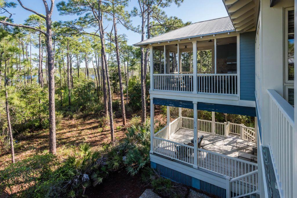 Two stories of porches overlooking western lake