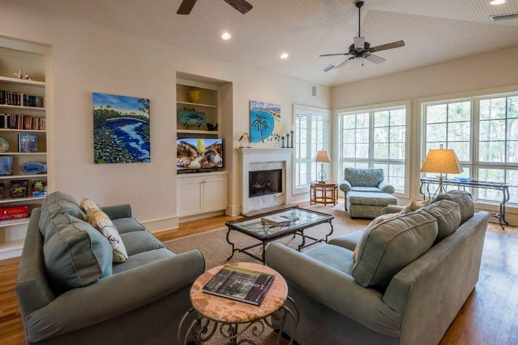 Large living room anchored by gas fireplace
