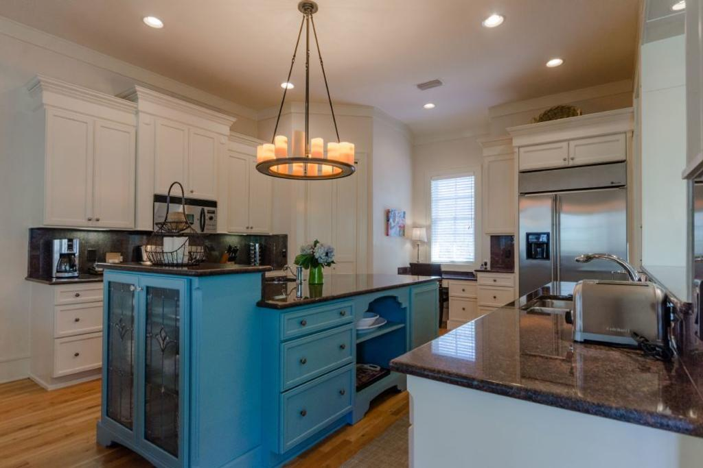 Alternate view of kitchen showing china cabinet