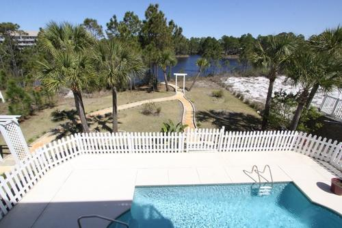 Private pool and large backyard overlooking lake