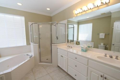 Master bathroom with tub and walk in shower
