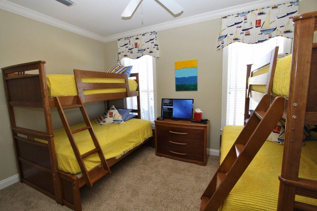 Bunk bedroom with lcd tv