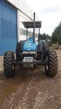 Trator New Holland TL 100 4x4 ano 99