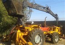 Trator Carregadeiras MF 297 com Implemater 1270  4x4 ano 85