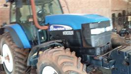 Conjunto Trator New Holland TM 180 + distribuidro de Taxa Variavel ( Jumil)