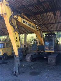 New Holland E215 Florestal com Havster - Escavadeira Florestal
