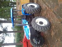 Trator Ford/New Holland TT-4030 4x4 ano 12