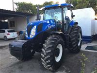 TRATOR AGRÍCOLA DE PNEUS NEW HOLLAND