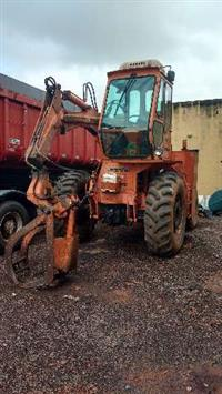 TRATOR NEW HOLLAND TL 4X4 COM GRUA