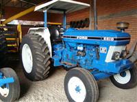 UM TRATOR AGRICOLA, MARCA FORD, MODELO 6610, ANO 1987, 4X2 COM COMANDO
